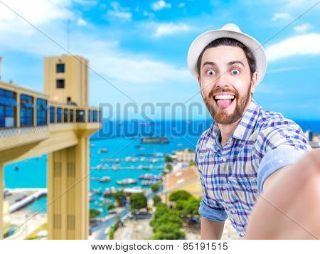 Happy young man taking a selfie photo in Salvador, Bahia