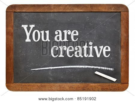 You are creative - positive affirmation words on a vintage slate blackboard