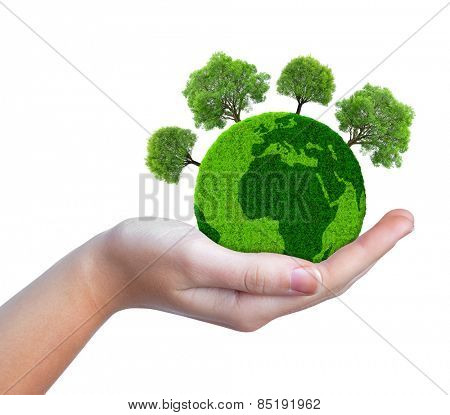 Hand holding green planet with trees isolated on white background