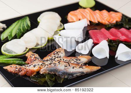 delicious mixed sashimi on a black plate