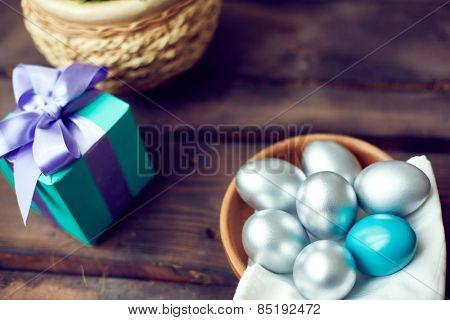 Silver eggs at a gift box