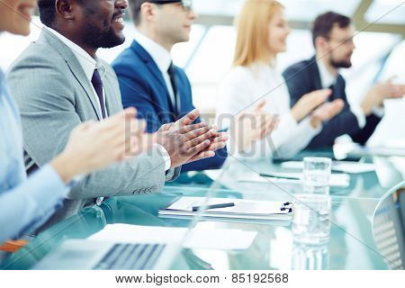Business people applauding at seminar