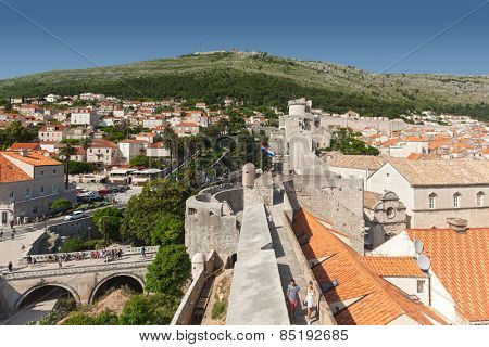 DUBROVNIK, CROATIA - MAY 26, 2014: View on Old city rooftops walls and and Srdj hill in the background.