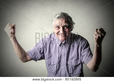 Elderly man jubilating