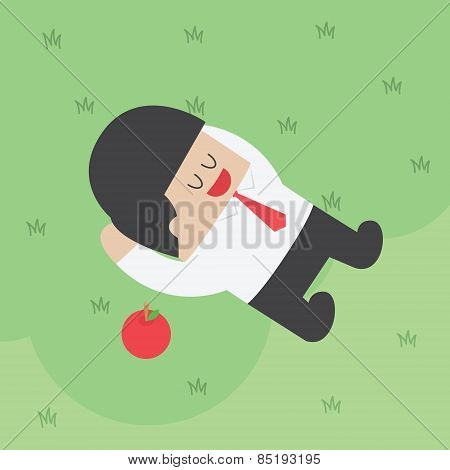 Businessman Relaxing Under The Tree With Apple