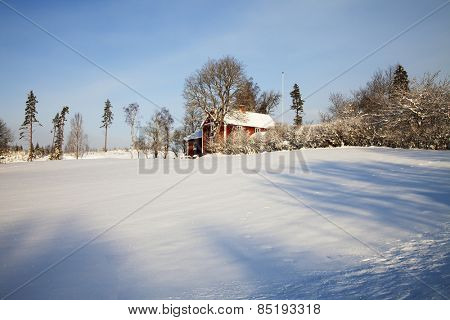 small farm, cottages draped in a snowy winter landscape, Sweden