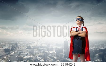 Girl of school age in super hero costume
