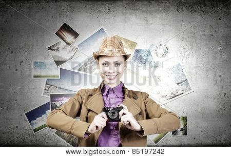 Young pretty woman with photo camera in hands
