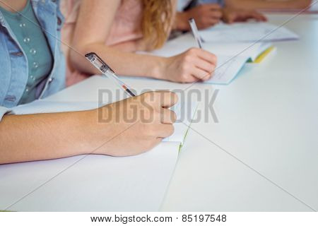 Students taking notes in class at the college