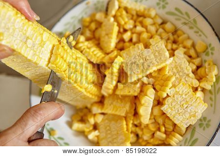 Preparing ingredient by cutting corn to make deep fried ote-ote, traditional indonesia snack
