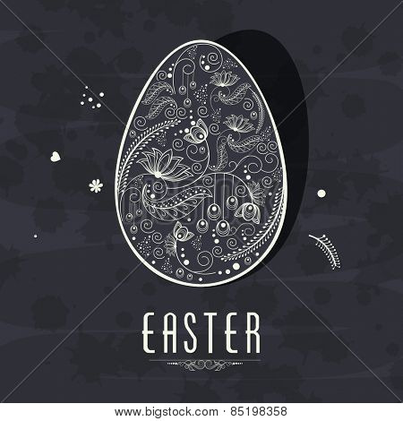 Beautiful floral design decorated Easter egg on grungy background.