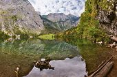 stock photo of reflection  - Magic reflection in German lake Koenigssee - JPG