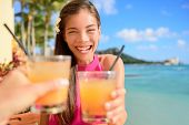 foto of hawaiian girl  - Beach bar party drinking friends toasting Hawaiian sunset cocktails having fun - JPG