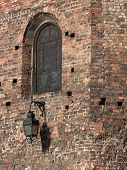 Historical lantern attached to a brick medieval wall poster