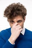 foto of farting  - Portrait of a man covering his nose - JPG