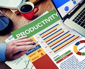 stock photo of productivity  - Productivity Businessman Working Calculating Thinking Planning Paperwork Concept - JPG