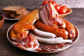 stock photo of deli  - Assortment of deli meats on wooden background - JPG