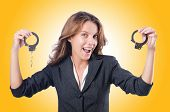 image of white collar crime  - Female businesswoman with handcuffs on white - JPG