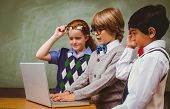 stock photo of classroom  - Little school kids using laptop in the classroom - JPG