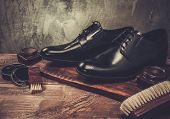 stock photo of grease  - Shoe care accessories on a wooden table  - JPG
