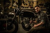 picture of rockabilly  - Mechanic building vintage style cafe - JPG
