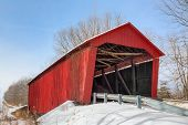 pic of covered bridge  - Built in 1922 in rural Putnam County Indiana the Edna Collings Covered Bridge spans Little Walnut Creek surrounded by winter snow - JPG