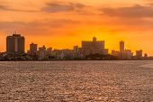 pic of malecon  - Beautiful colorful sunset in Havana with a view of the ocean and the city skyline - JPG