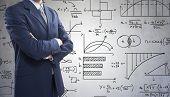 image of formulas  - Businessman in front of math formulas - JPG