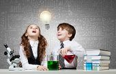 picture of chemistry  - Two cute children at chemistry lesson making experiments - JPG