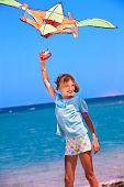 picture of kites  - Child flying kite beach outdoor - JPG