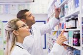 picture of hospitals  - Team of pharmacists looking at medicine at the hospital pharmacy - JPG