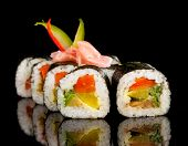 picture of dragon-fish  - Delicious sushi rolls served on black table - JPG