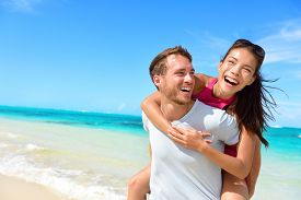 pic of beach holiday  - Happy couple in love on beach summer vacations - JPG