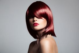 stock photo of hair dye  - Beautiful red hair model with perfect glossy hair - JPG