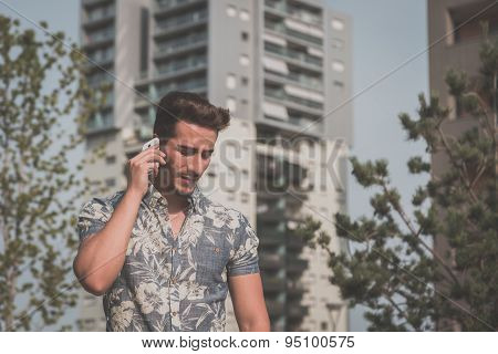 Young Handsome Man Talking On Phone In The Street