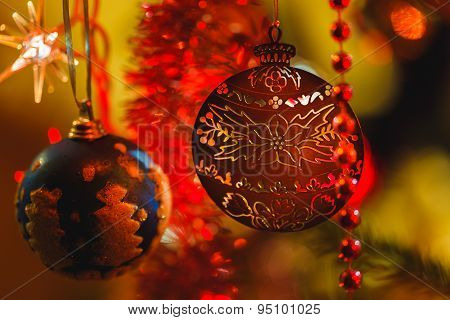 Golden Ornament In Christmas Tree Surrounded By Colorful Lights