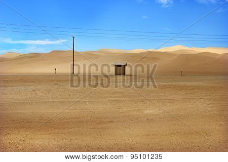Hut in Desert Sand Dunes