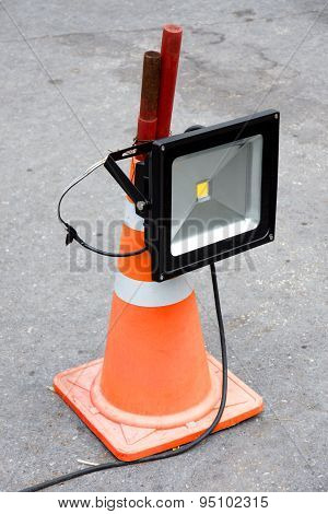 Led Energy Saving Industrial Flood Light Mounted On Orange Striped Rubber Cone