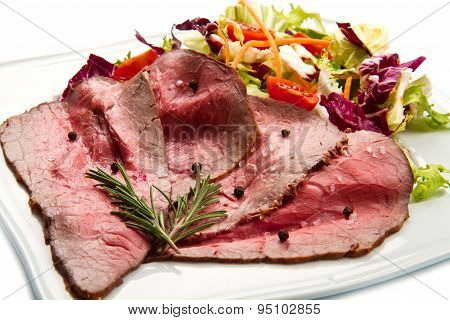 Roastbeef On White Dish With Salad