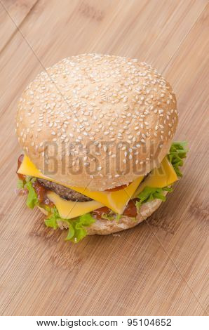 Tasty cheeseburgers with lettuce; beef; double cheese and ketchup. Shallow focus.