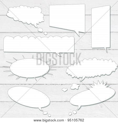 Vector speech bubbles with shadow like clouds on white wooden wall