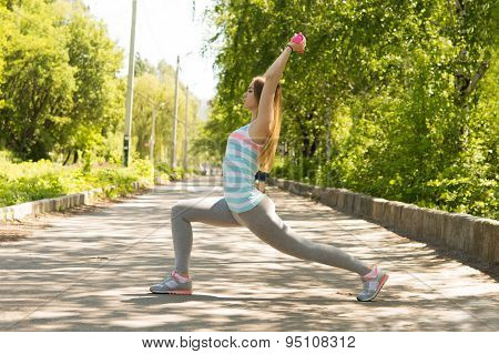 Happy Sport Woman Doing Lunges With Dumbbells In The Park In The Park In Sunny Morning.