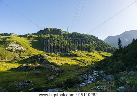 Alpine Landscape At Sunrise In Summertime
