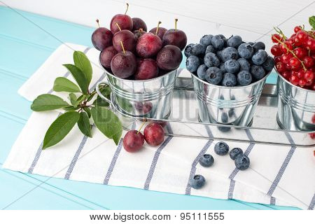 Plums, Red Currants And Blueberries In Small Metal Bucket