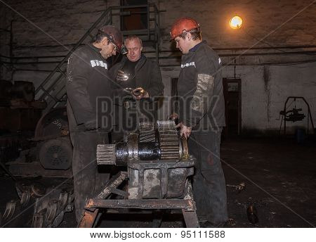 Zorinsk, Ukraine - March 18, 2013: Locksmiths Repair Of Mining Equipment. Mine Nicanor - New