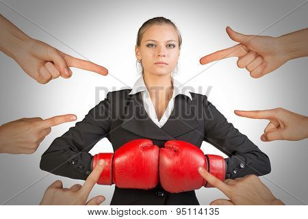 Businesslady in boxing gloves