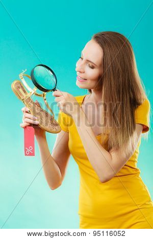 Woman Choosing Shoes Searching Through Magnifying Glass