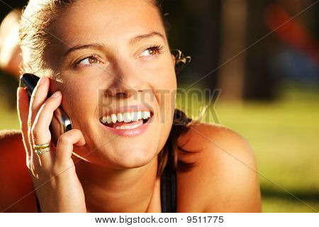Young Pretty Wife On The Phone In The Park