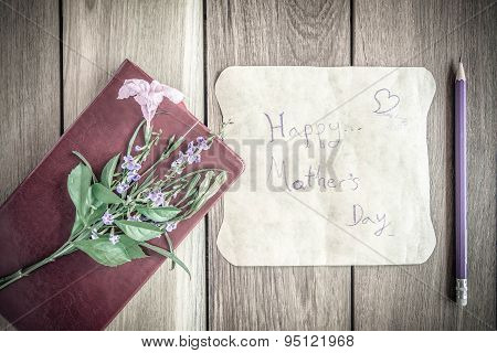 Mothers Day Card With Red Book On Wooden Board