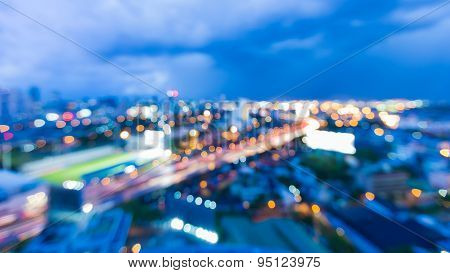 Blur bokeh lights of cityscape during twilight